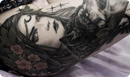 Татуировка девушка и волк
