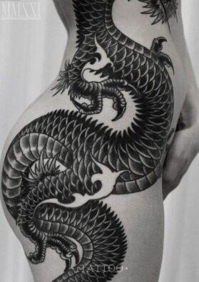 Тату на бедре дракон