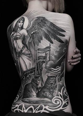 Женская тату спина