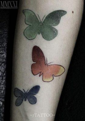 Тату три бабочки